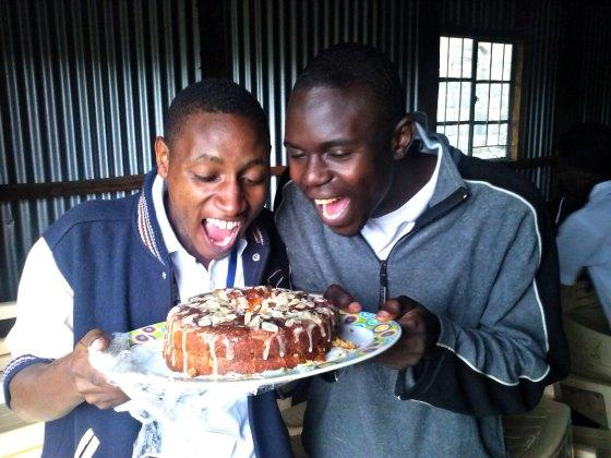 Joel and Cosmas eating cake
